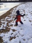 Charlie throwing snowballs